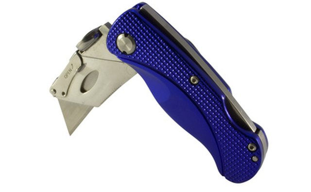 A heavy duty utility knife is fine for single stall mats.