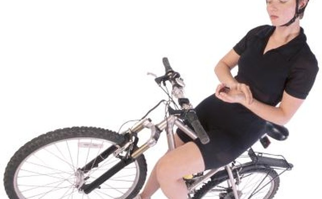 Woman taking her pulse on bike
