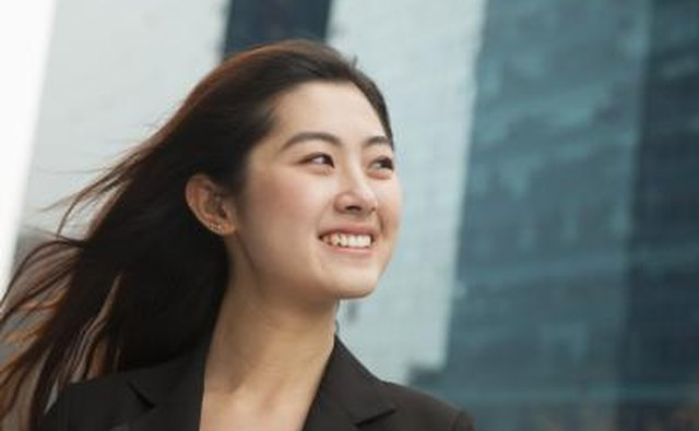 Business woman smiling outside office