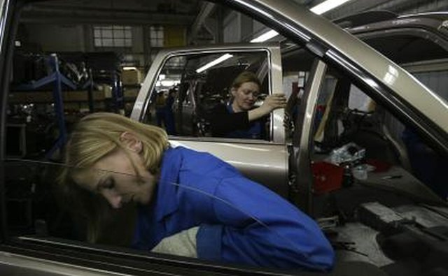 Workers assemble KIA automobile