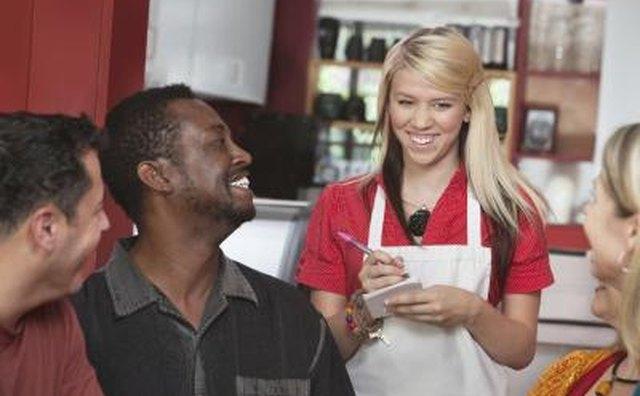 Teenage waitress at work