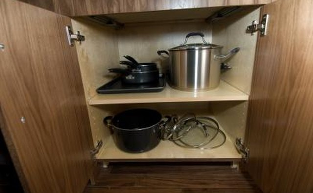 Add pull-out shelves to reach items in the back of your cabinet.