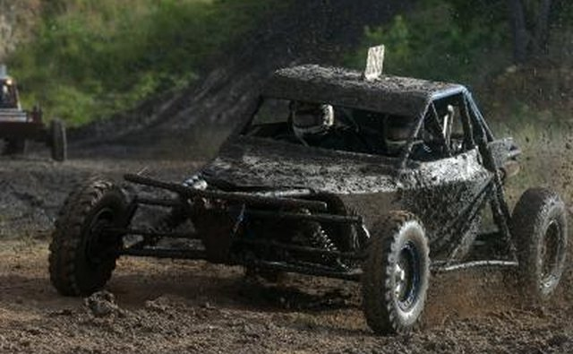 Off-road buggy racing in the mud