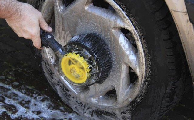 Use a stiff scrubbing brush to scrub off the tar.