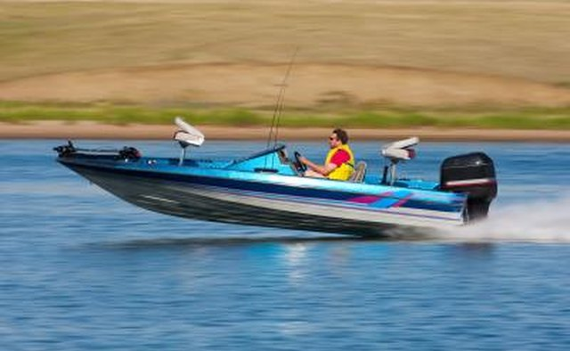 Speed boat on lake with Mercury outboard
