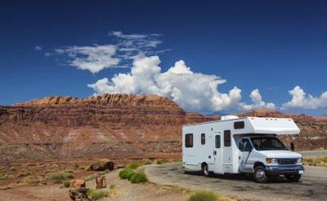 A Class C motorhome is bigger than a Class B and has an overhead sleeping area.