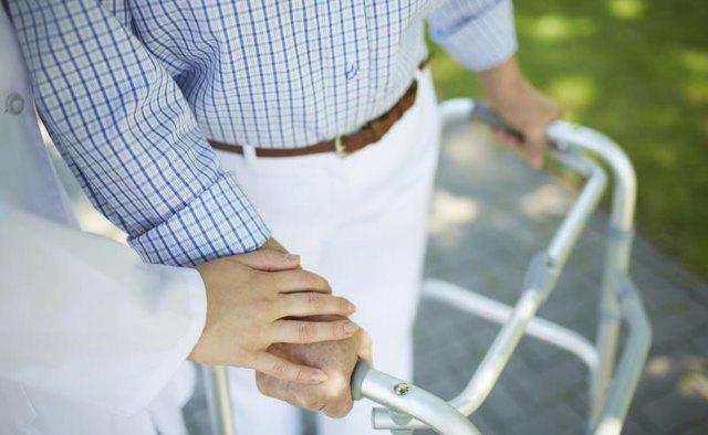 Senior man using walker outdoors