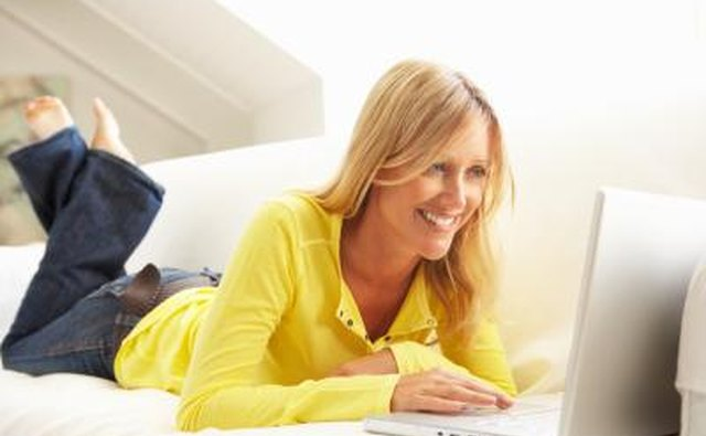 woman editing on computer