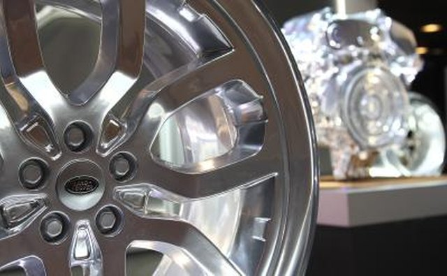 Range Rover rim and engine on display