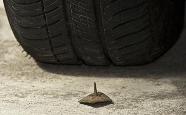 Nail in front of car tire