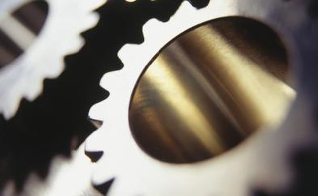 Gears are parts of metal that mesh and grind together.