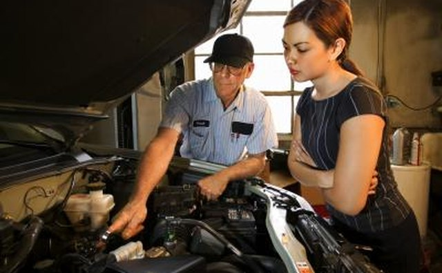 Mechanic looking at car coolant system