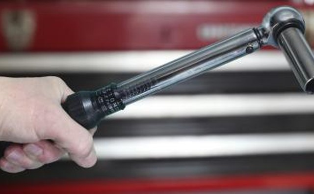 Man holding torque wrench