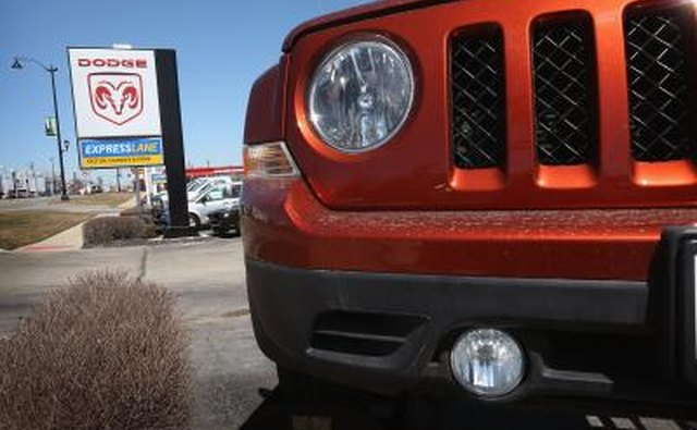 Front detail of a Jeep Patriot at car dealer