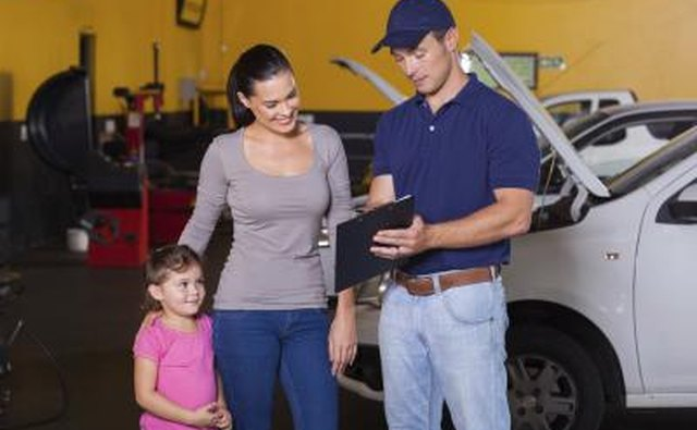 woman speaking with car mechanic