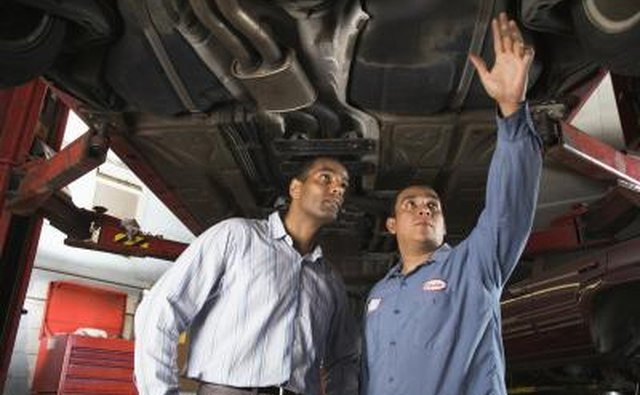 Mechanic showing car to customer