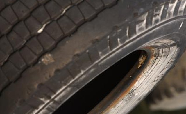 Old tire showing uneven wear on tread