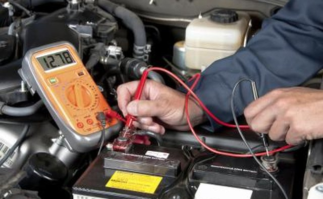 Place the red test lead from the multi-meter on the positive post of the battery.