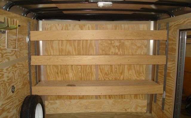 Plywood shelves supported on vertical E-track