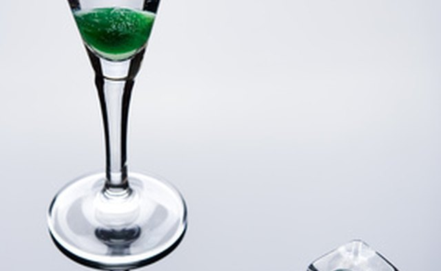 Ad for alcohol using ice cubes, green cherries, glass shapes and reflections to associate the product with sex organs.