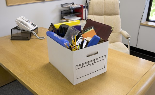Box of office supplies on desk