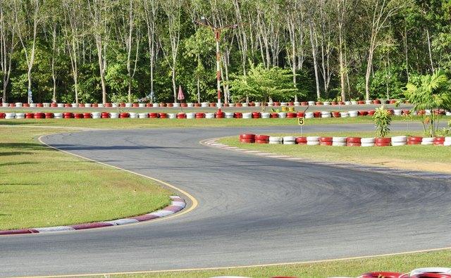 Turn on a empty race car circuit.