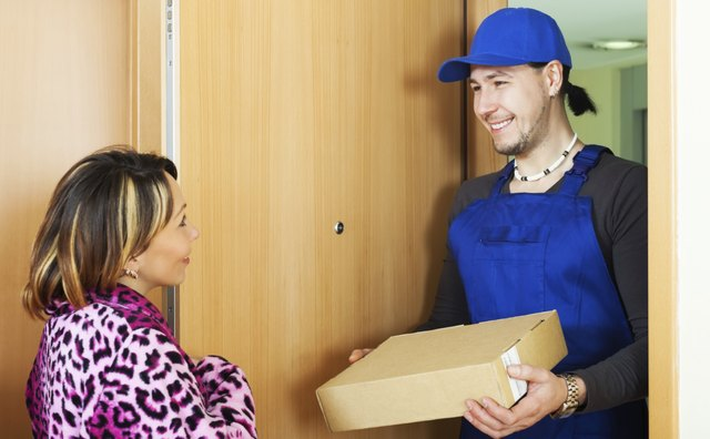 Postman delivered a parcel to woman