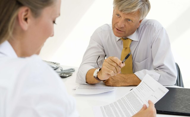 Woman with document and financial adviser