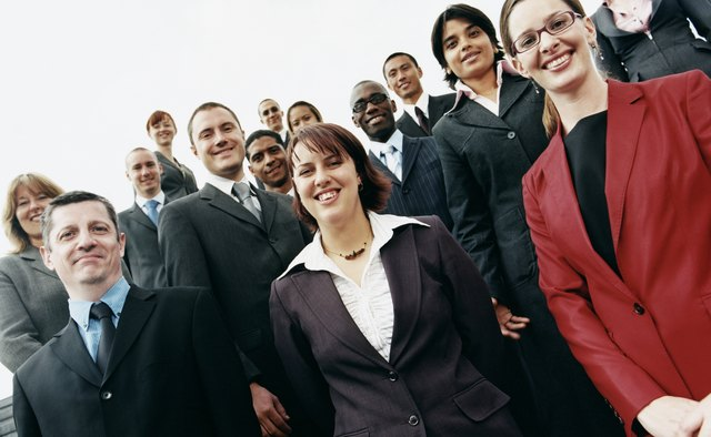 Large Group of Office Colleagues Stand Together Smiling
