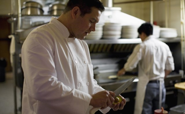 cooks working in kitchen