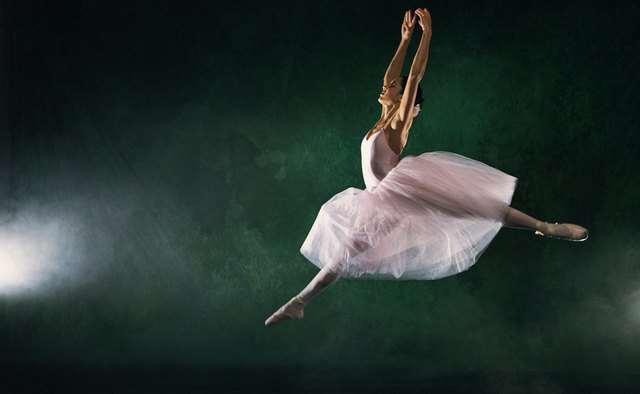 Ballerina leaping across stage