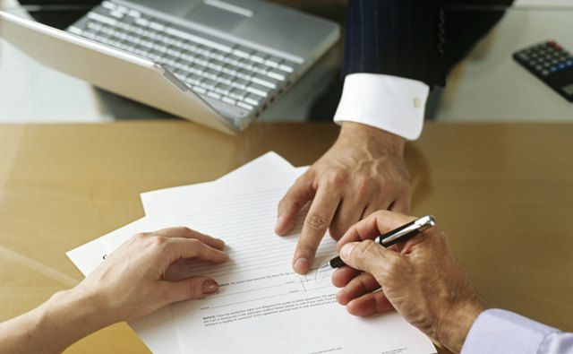 Businessman and couple signing documents,close-up of hands