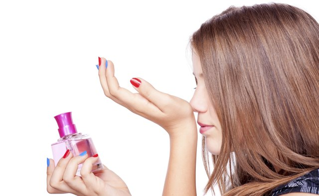 Girl smelling perfume