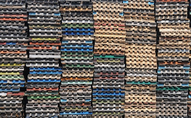 Stockpile of colored wooden pallets