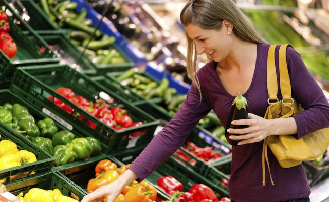 Woman in supermarket shopping groceries
