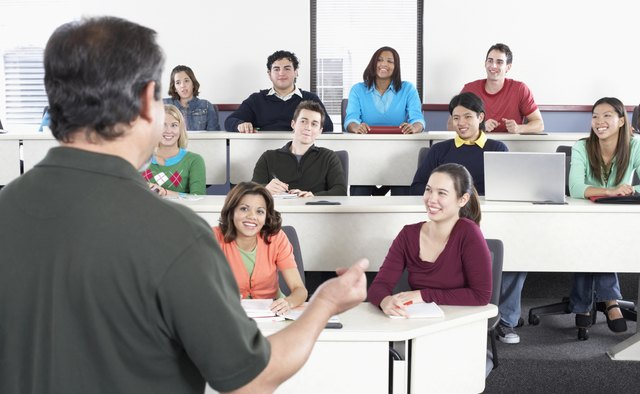 Male lecturer teaching a class of students