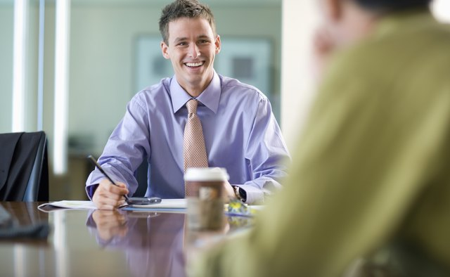 Young Businessman Smiling During Meeting