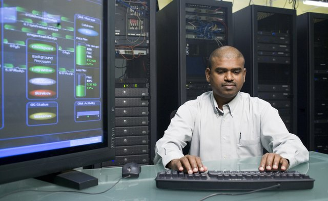Technician working on a network server