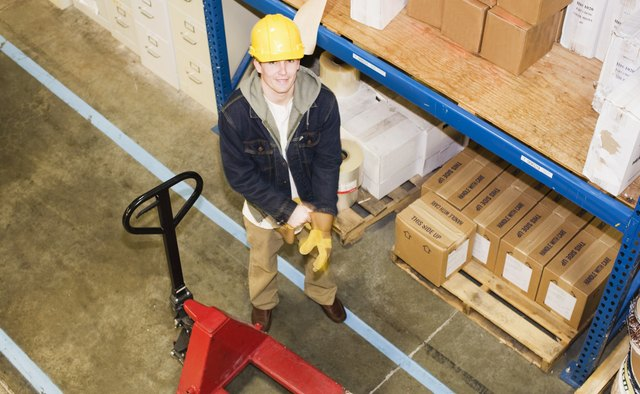 High angle view of smiling warehouse worker
