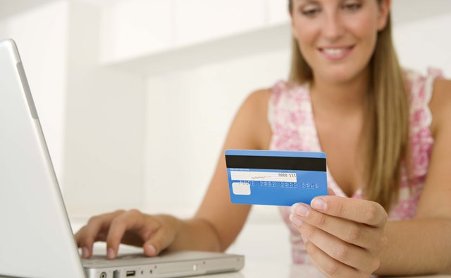 Woman with credit card and laptop
