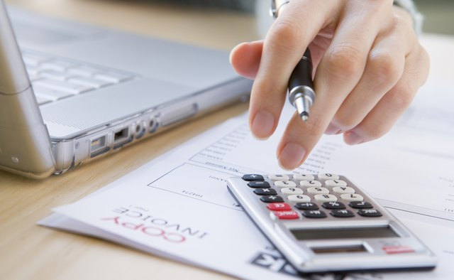woman calculating savings amount