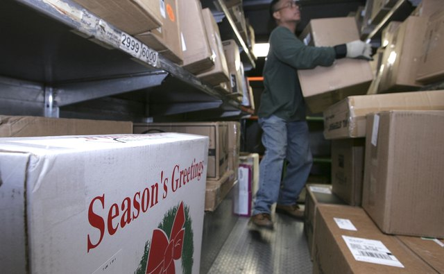 UPS And FedEx Deliver Packages As Holiday Shopping Season Begins