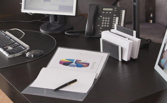 Paperwork on desk in office