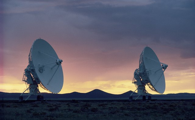 Pair of radio telescopes at sunset