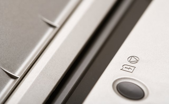Close-up of feed button on computer printer