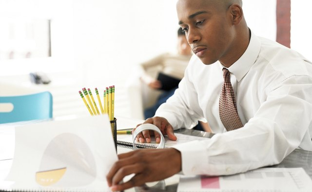 Businessman studying reports