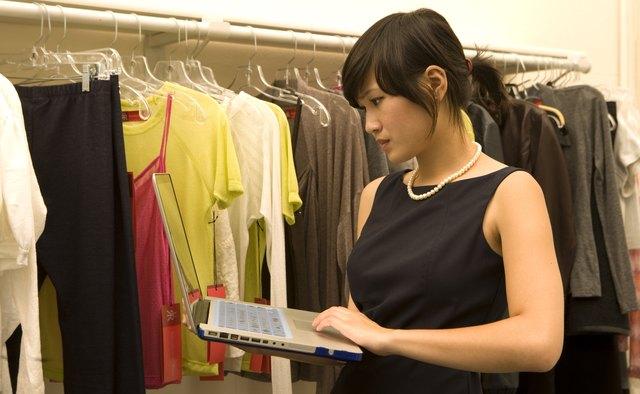 Fashion designer working on laptop