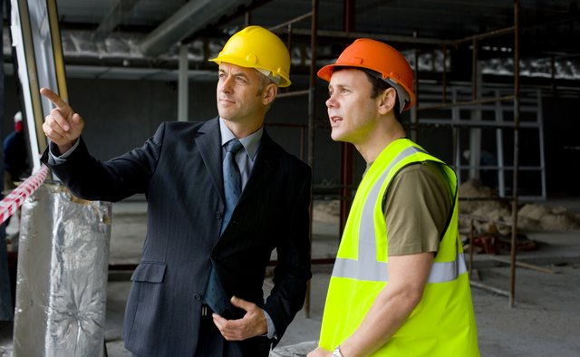 Foreman and architect at construction site