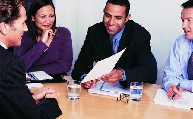 Three Business Colleagues Interviewing a Businessman