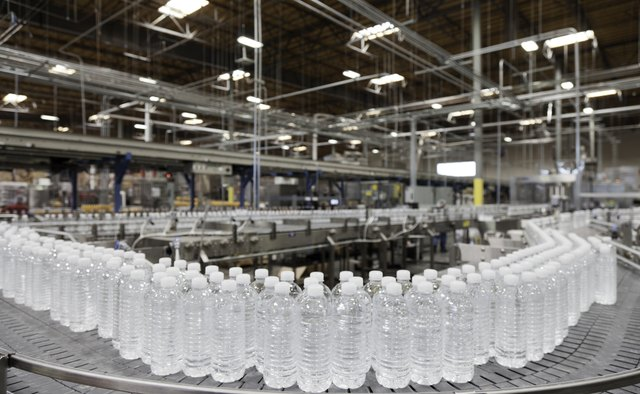 Bottled water on conveyor at bottling plant